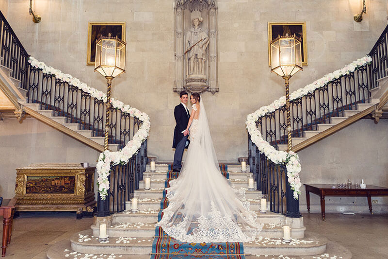 Wedding couple on stairs at Ashridge House